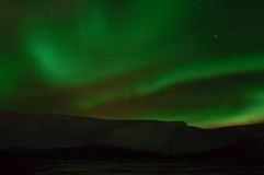"Aurora polaris â""–5. Arctic radiances above a mountain valley stock photography"