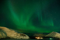 Aurora polaris. Above the comb of mountains royalty free stock photography