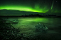 Aurora polaris above water Stock Photography