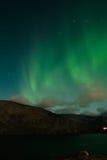 Aurora polaris an autumn. Game of Aurora polaris above autumn mountains royalty free stock photography