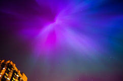 Aurora polaris Borealis space star city lights night sky Stock Photo