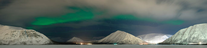 Aurora polaris and clouds. Pushing through clouds Aurora polaris royalty free stock photo