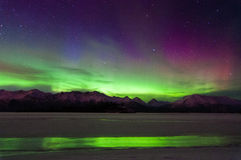Aurora Reflection. The Northern green and purple lights that reflected onto the ice Stock Photography
