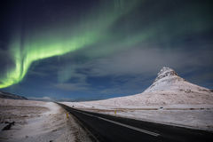 Aurora Road. The aurora dances over an Icelandic road Royalty Free Stock Photo