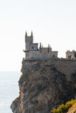 Aurora rock with Swallow's Nest castle at sunrise Stock Photos