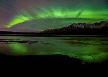Aurora shines bright. The aurora over an Alaskan mountain-range Stock Photo