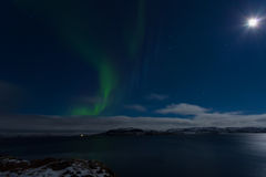 Aurora in the sky in a full moon Stock Photos