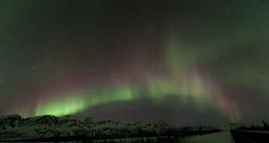 Aurora sobre montanhas Foto de Stock