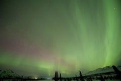 Aurora sobre montanhas Foto de Stock Royalty Free