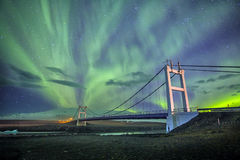 Auroral display over the bridge Iceland. Royalty Free Stock Photography