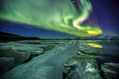 Auroral over the glacier lagoon Jokulsarlon in Iceland. Royalty Free Stock Images