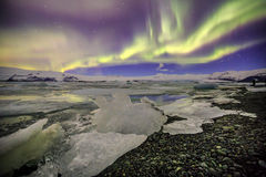 Auroral over the glacier lagoon Jokulsarlon in Iceland. Stock Images