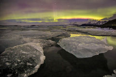 Auroral over the glacier lagoon Jokulsarlon in Iceland. Stock Photos