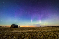 Auroras in the countryside. Auroras appeared after sunset in Finnish countryside Stock Image