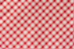 Aus Fokus-Hintergrund heraus Rotes Plaidmuster Stockbilder