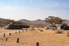 Aus, Namibia - September 3, 2016: Camping cars and camping gear in the Namib desert, Adventure traveling in Namibia, Africa. Outdo stock photo