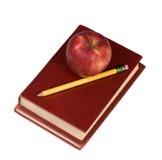 Ausbildungs-Serie (Apfel und Buch 2) Lizenzfreie Stockfotografie