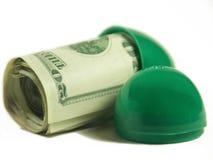 Ausbrüten des Geldes stockbild