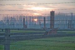 Auschwitz. II barracks behind barbed wire Stock Photography