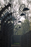 Auschwitz Barbed Wire and lamps. A double row of barbed wire separated the barracks of the prisoners and the house of the guards in the concentration camp Royalty Free Stock Photography