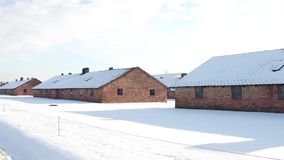 Auschwitz Birkenau barracks in winter. German Nazi concentration and extermination camp Stock Image