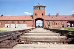 Auschwitz Birkenau main entrance with railways. Auschwitz Birkenau main control tower in the entrance with railways leading to it Stock Photos