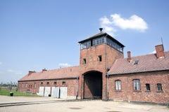 Auschwitz Birkenau main entrance with railways. Auschwitz Birkenau main control tower in the entrance with railways leading to it Stock Image