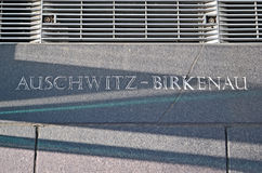 Auschwitz - birkenau, message closeup on stone wall, Royalty Free Stock Photo