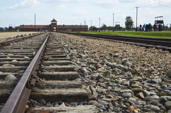 Auschwitz Birkenau Museum. OSWIECIM, POLAND -  SEPTEMBER 19, 2015: Rail road and main entrance to Auschwitz Birkenau Concentration Camp Royalty Free Stock Photography