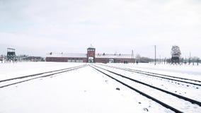 Auschwitz Birkenau Nazi concentration camp and railroad tracks in winter Stock Photo