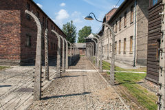 Auschwitz - buildings and barb wire fence Royalty Free Stock Photo