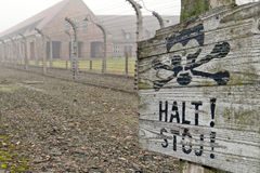 Auschwitz camp sign. Auschwitz concentration camp is located about 50 km from Krakow. The sign that is written in german and polish. It means Stop. In the Stock Photography