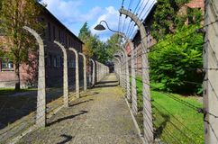 Auschwitz concentration camp fences. AUSCHWITZ BIRKENAU POLAND 09 17 17: Auschwitz concentration camp fences was a network of German Nazi concentration camps and royalty free stock photo