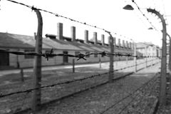 Auschwitz concentration camp, Germany - prison and barbed wire fence - on 15.06.2017. Evil and violence symbol. Sorrow and sad place Royalty Free Stock Images