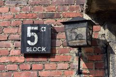 Auschwitz Concentration Camp. Lamp and sign at entrance to Block 5 at Auschwitz I Nazi concentration camp Royalty Free Stock Images