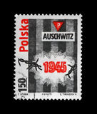 Auschwitz concentration camp, Poland. POLAND - CIRCA 1975: vintage cancelled stamp printed in Poland shows Auschwitz concentration camp Royalty Free Stock Photography