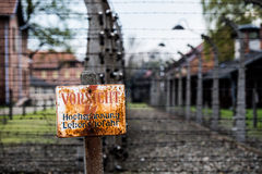 Auschwitz Concentration Camp. Warning sign in the former concentration and extermination camp Auschwitz-Birkenau, Poland Royalty Free Stock Image