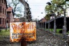 Auschwitz Concentration Camp. Warning sign in the former concentration and extermination camp Auschwitz-Birkenau, Poland Stock Photos