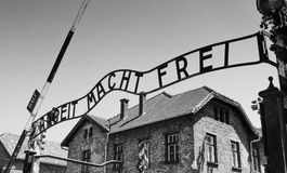 Auschwitz Concentration Gate, ARBEIT MACHT FREI sign. Sunny day on the July 7th, 2015. Black and white. Krakow, Poland Stock Image