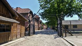 Auschwitz Concentration Gate, ARBEIT MACHT FREI sign. Sunny day on the July 7th, 2015 - Krakow, Poland. EU Royalty Free Stock Images