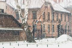 Auschwitz Concentration Gate on a winter day. AUSCHWITZ  POLAND 02 04 15: Auschwitz Concentration Gate, ARBEIT MACHT FREI Stock Photo