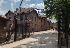 Auschwitz Entrance. The entrance sign of Auschwitz, Arbeit Macht Frei, the work will set you free and the brick buildings, south of Poland Stock Photos