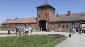 Auschwitz II - Birkenau entrance with visitors on the July 6th, 2015 - Krakow, Poland. Europe Stock Images