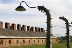 Auschwitz II -Birkenau Extermination camp accommodation and wire fence Royalty Free Stock Photo