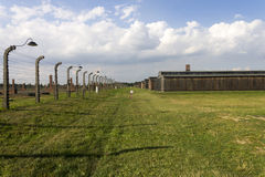 Auschwitz II -Birkenau Extermination camp barbed wire fence and wooden housing Stock Photography