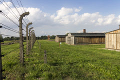 Auschwitz II -Birkenau Extermination camp barbed wire fence and wooden housing Royalty Free Stock Photos