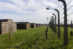 Auschwitz II -Birkenau Extermination camp barbed wire fence and wooden housing Royalty Free Stock Photography