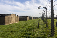 Auschwitz II -Birkenau Extermination camp barbed wire fence and wooden housing Stock Photos