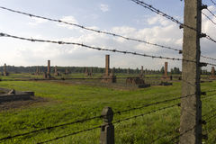 Auschwitz II -Birkenau Extermination camp outdoors behind a barbed wire fence Stock Photos