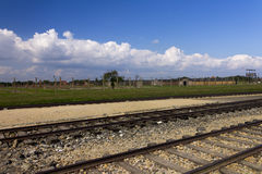 Auschwitz II -Birkenau Extermination camp outdoors and rail tracks Royalty Free Stock Photo